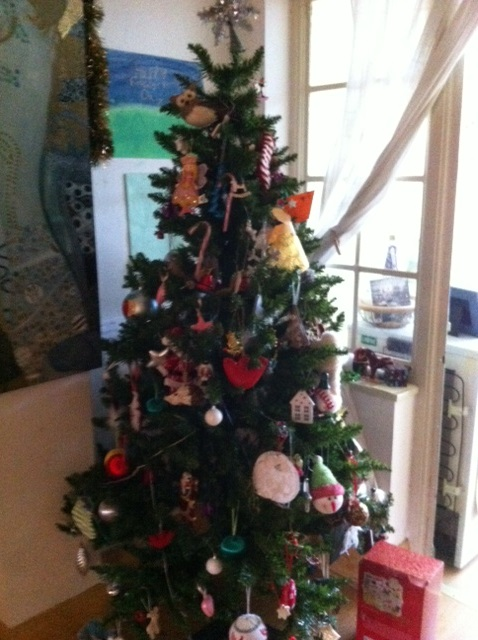 This year's tree with our eclectic collection of decorations.